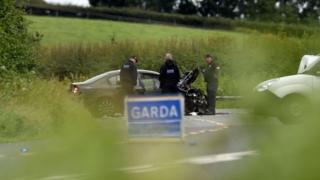 Garda (Irish police) examine one of the three vehicles involved in the fatal crash