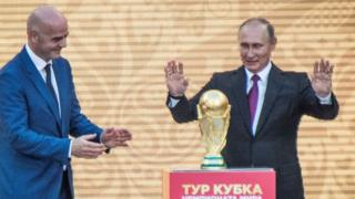 Vladimir Putin with the 2018 World Cup trophy