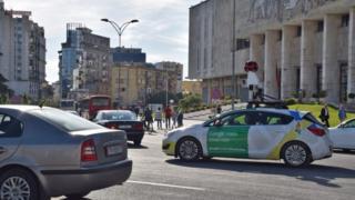A Google street view car (R) drives through the streets of Tirana, Albania, 01 May 2016.