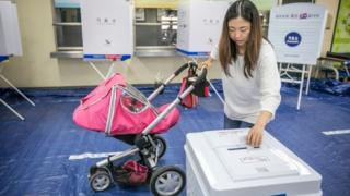 A woman casts her ballot in South Korean presidential elections