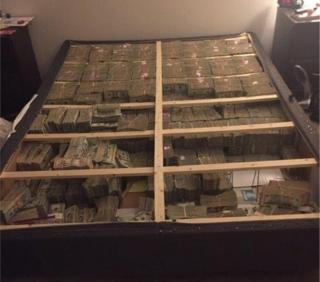 A US Attorney's office photo shows $20m seized in a box spring of a bed in Massachusetts.
