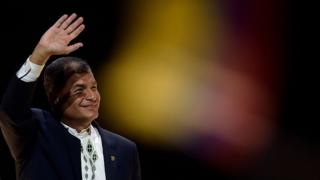 Ecuadorean President Rafael Correa waves to his audience