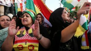 Iraqi Kurds take part in a demonstration outside the US consulate in Irbil on 21 October 2017