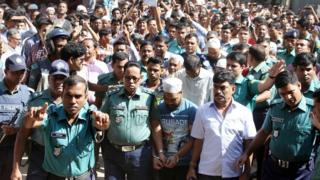 Police escort one of the accused to the courtroom in Sylhet - 8 November