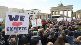 People gather in front of the Brandenburg Gate in support of scientific research during the March for Science in Berlin, Germany, 22 April 2017
