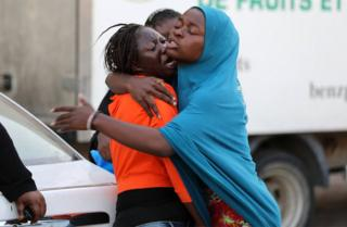 A migrant, who was not allowed to return to her country with other migrants for not having complete documents, cries as she is comforted at a detention center inTripoli, Libya, August 29, 2017.
