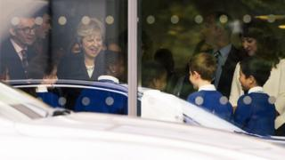 Prime Minister Theresa May talks to primary pupils during a visit to the Dunraven School in Streatham, south London, ahead of the publication of details of the Government's Race Disparity Audit
