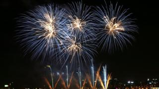 Fireworks illuminate the sky over downtown Seoul
