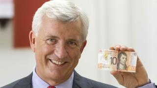 CYBG boss David Duffy with new polymer note