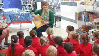 Children and staff in the Family Library