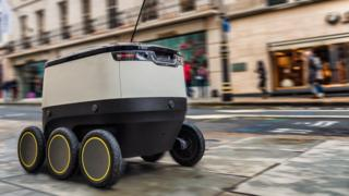 Self-driving robot navigating a London street
