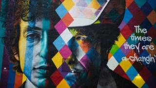 A mural of songwriter Bob Dylan by Brazilian artist Eduardo Kobra is on display in downtown Minneapolis, Minnesota on October 15, 2016. On October 13, 2016, Dylan was awarded the Nobel Prize in Literature.