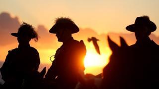 World War One re-enactors take part an Anzac Day dawn service in Australia