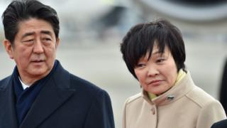 Shinzo Abe (L) and his wife Akie Abe