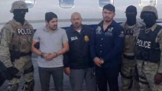 Efrain Antonio Campo Flores (second from left) and Franqui Francisco Flores de Freitas arrested in Haiti on 12 NOvember 2015