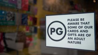 PG sign in window of Scribbler store