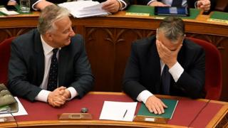Hungarian Prime Minister Viktor Orban (R) and deputy Prime Minister Zsolt Semjen (L) attend a session at parliament on 8 November 2016 in Budapest, after a parliamentary vote on a constitutional amendment to ban the mass relocation of migrants