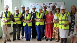 Christine Evans-Thomas of Adam's Bucketful of Hope and Bernie George, trustee of the Withybush Hospital Cancer Day Unit Appeal join guests in marking the start of construction work.