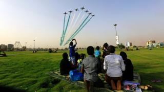 People look at Saudi Air Force perform from the Green Square near Khartoum Airport, Khartoum, Sudan, April 12, 2017