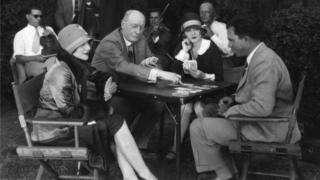 Circa 1928: Hollywood director King Vidor Jane Winton and actress Marion Davies learning the art of bridge from Milton York, the international player.