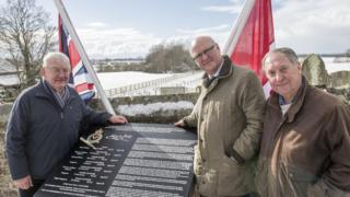 North Yorkshire County Councillor Peter Sowray, chairman of the War Memorial Committee Nigel Denison, and Roger Clements of Brafferton Parish Council with the new memorial