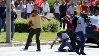 Turkish journalists are attacked by supporters of President Recep Tayyip Erdogan at a protest following the coup attempt