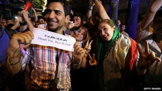 Iranians celebrate after Iran's nuclear negotiating team struck a deal with world powers in Vienna, on 14 July, 2015