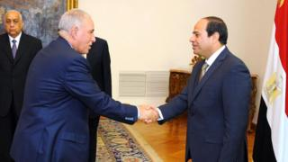 """A file handout picture made available by the Egyptian presidency on May 20, 2015 shows Egyptian President Abdel Fattah al-Sisi (R) shaking hands with Egypt""""s Justice Minister Ahmed al-Zind"""