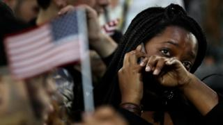 A woman weeps as election results are reported