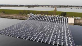 Solar photovoltaic panels are being laid on the surface of the Queen Elizabeth II reservoir near Walton-on-Thames, England