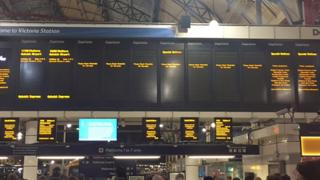Empty departure boards at London Victoria station