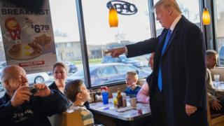 Republican presidential candidate Donald Trump chats with patrons and workers at a George Webb diner following an interview with Fox News on April 5, 2016 in Wauwatosa, Wisconsin