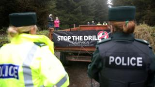 Police watch protesters at Woodburn forest