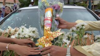 Cambodians lay flowers on the car carrying the body of political analyst Kem Ley, shot dead on Sunday in Phnom Penh (10 July)