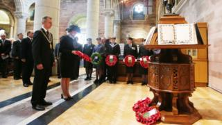 First Minister Arlene Foster lays a wreath during the service