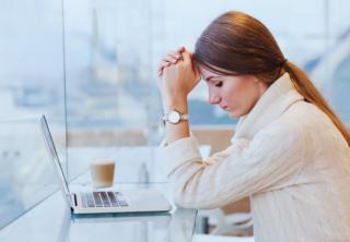 Woman looking stressed at computer