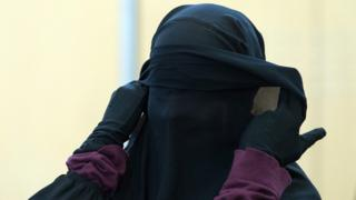Suspected Islamic State supporter Jennifer Vincenza M stands in the courtroom before the beginning of her trial in Duesseldorf, Germany, 21 January 2015