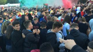 Wales fans in Cardiff celebrate their team's early lead