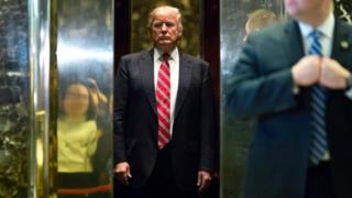 Donald Trump boards the elevator after escorting Martin Luther King III to the lobby after meetings at Trump Tower in New York City