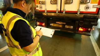Woman checking goods in lorry