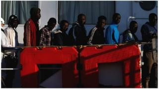 Rescued migrants wait to disembark from the Malta-based NGO Migrant Offshore Aid Station (MOAS) ship Phoenix in Pozzallo on the island of Sicily, Italy, 6 April 2017