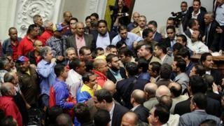 Deputies of the Venezuelan coalition of opposition parties (MUD) and of the Venezuela's United Socialist Party (PSUV) scuffle during a session of the National Assembly in Caracas, Venezuela October 25, 201