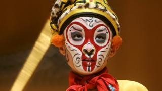 A young student performs as 'Monkey God' at the Peking Opera in Beijing