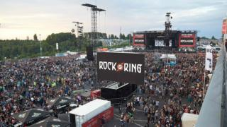 Festival-goers leave the venue of the Rock am Ring music festival in Nuerburg, 2 June