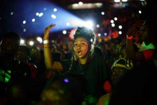 A woman sings during the concert of Malian musician Sidiki Diabate at Modibo Keita Stadium in Bamako on September 3, 2017. Diabate is one of the most popular Afro Trap singers in Mali and Africa. He also plays the kora and contributed to the album Lamomali with Matthieu Chedid and his father renowned kora player Toumani Diabate.