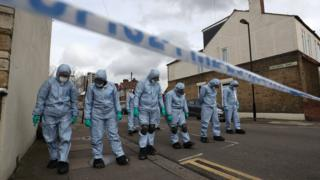 Forensic officers searching the streets