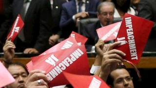 "Opposition deputies hold papers that read, "" Impeachment now!"" during ballot to appoint a committee to report on whether to impeach Brazil""s President Dilma Rousseff"