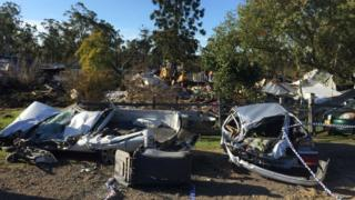 The incident left cars flattened and a house razed