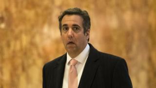 Michael Cohen walks in Trump Tower.