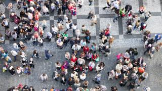Aerial shot of a crowd in a Czech square
